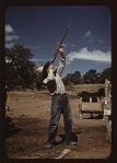 Mr. Leatherman, homesteader, shooting hawks which have been carrying away his chickens, Pie Town, New Mexico