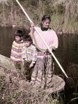 Seminole woman and children gigging frogs near the Tamiami Trail