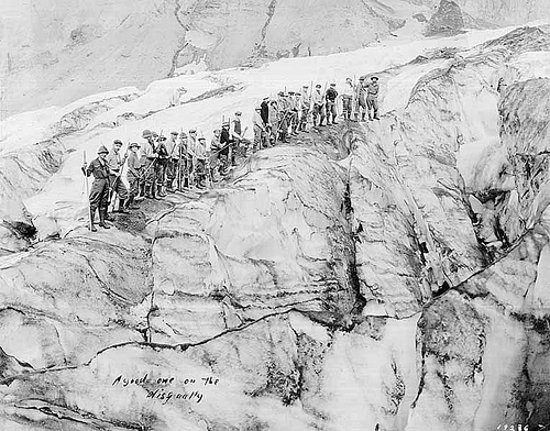 Guides Alma Wegen and Fairman B. Lee with a climbing party on Nisqually Glacier, Mount Rainier National Park