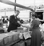Man selling artichokes at vegetable market in Stockholm 1951 2